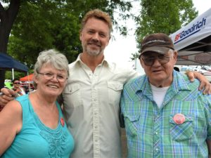 Sue Fink & husband at Car Show with John Schneider